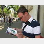 HU Budapest - Guido Reading Lonely Planet on Andrássy Road