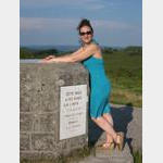 Suc-au-May - Leticia Leaning over Memorial Stone